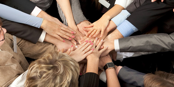 corporate hands together
